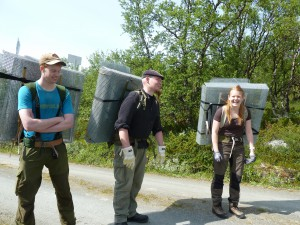 Øystein Opedal, Christian Stærke Hansen, and Kristin Odden Nystuen and Øystein Opedal ready to carry up the exclosures. Photo: Mia Vedel Sørensen